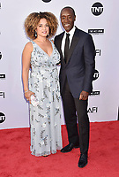 HOLLYWOOD, CA - JUNE 07: Bridgid Coulter (L) and Don Cheadle arrive at the American Film Institute's 46th Life Achievement Award Gala Tribute To George Clooney at the Dolby Theatre on June 7, 2018 in Hollywood, California.<br /> CAP/ROT/TM<br /> &copy;TM/ROT/Capital Pictures