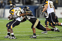 26 September 2009:  FIU linebacker Toronto Smith (13) attempts to tackle running back DaJuane Collins (22) in the fourth quarter of the Toledo 41-31 victory over FIU at FIU Stadium in Miami, Florida.