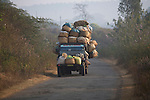 "FEBRUARY 12 & 13, 2009 : JEEP-TAXIS ON THE WAY TO THE MARKET IN SOUTHWESTERN ORISSA. BONDAS, GADABAS , TRIBALS COME FROM THE HILLS FOR THE THURSDAY MARKET IN ONUKUDELLI, SOUTH OF JEYPORE IN WESTERN ORISSA. THIS IS PART OF INDIA'S TRIBAL BELT. THE BONDA  OR BONDO ARE AN ANCIENT TRIBE OF PEOPLE NUMBERING APPROX 5000 WHO LIVE IN THE ISOLATED HILL REGION OF SOUTHWEST ORISSA, THE BONDA ARE A SCHEDULED TRIBE IN INDIA AND ARE ALSO KNOWN AS REMO (MEANING ""PEOPLE"" IN BONDA LANGUAGE). THE TRIBE IS THE OLDEST AND MOST PRIMITIVE IN MAINLAND INDIA AND THEIR CULTURE HAS LITTLE CHANGED IN OVER THOUSAND YEARS. THEIR ISOLATION AND AGGRESSION PRESERVED THEIR CULTURE DESPITE THE PRESSURE OF AN EXPENDING INDIAN POPULATION. WOMEN WEAR THICK SILVER NECKLACE BANDS AND LONG COLORFUL NECKLACES MADE OF BEADS."