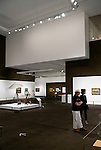 Visitors enjoy an exhibition of Impressionist works inside the temporary gallery at the Aomori Museum of Art in Aomori City, Aomori Prefecture, Japan on 11 July, 2001. The Painting Light exhibition continues until 10 Oct. 2011. .Photographer: Robert Gilhooly