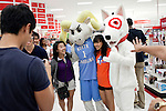 August 20, 2011. Chapel Hill, NC.. UNC students brought to the local Super Target by company chartered buses pose with Ramses, the school mascot and Bullseye, the Target mascot. Target hired the buses and staged sales to encourage students to buy items in the store that they might need for their dorm rooms.. Many companies have increased their efforts to reach the youth market by employing popular college students to raise the awareness of the brand by peer to peer marketing on campus' around the country.