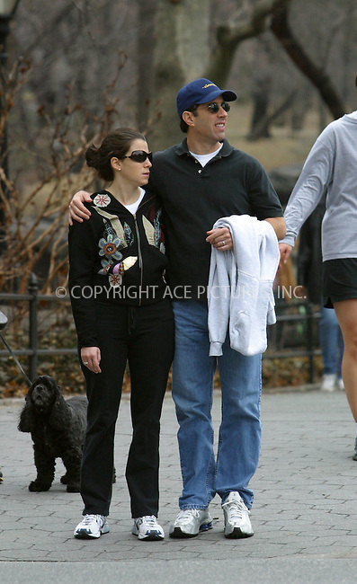 ***EXCLUSIVE***..Comedian Jerry Seinfeld and his wife Jessica wear matching white sneakers as they step out for a stroll in their neighborhood. The happy couple recently welcomed their second child, a boy, Julian Kal Seinfeld. New York, March 21, 2003. Please byline: Alecsey Boldeskul/NY Photo Press.   ..*PAY-PER-USE*      ....NY Photo Press:  ..phone (646) 267-6913;   ..e-mail: info@nyphotopress.com