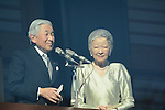January 2, 3014, Tokyo, Japan - Japan's Emperor Akihito gives New Year's gretings to thousands of flag-waving well-wishers during a general audience at the Imperial Palace in Tokyo on Thursday, January 2, 2014. Standing next to the 80-year-old monarch is Empress Michiko. More than 80,000 well-wishers turned out to celebrate the coming of the new year with the imprerial family who made five appearances on the palace balcony.  (Photo by Kaku Kurita/AFLO) FYJ -mis-