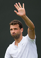 Gregor Dimitrov (13) of Bulgaria celebrates his victory over Dudi Sela of Israel in their Men's Singles Third Round Match today - Dimitrov def Sela 6-1, 6-1 retired<br /> <br /> Photographer Ashley Western/CameraSport<br /> <br /> Wimbledon Lawn Tennis Championships - Day 6 - Saturday 8th July 2017 -  All England Lawn Tennis and Croquet Club - Wimbledon - London - England<br /> <br /> World Copyright &not;&copy; 2017 CameraSport. All rights reserved. 43 Linden Ave. Countesthorpe. Leicester. England. LE8 5PG - Tel: +44 (0) 116 277 4147 - admin@camerasport.com - www.camerasport.com