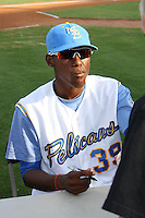 "Myrtle Beach Pelicans pitcher Julio Teheran #39 signing autographs for fans on ""Julio Teheran Poster Night"" before a game vs. the Wilmington Blue Rocks at BB&T Coastal Field in Myrtle Beach,SC on July 20, 2010.  Myrtle Beach defeated Wilmington by the score of 5-4.  Photo By Robert Gurganus/Four Seam Images"