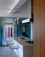 This dressing room backs onto the kitchen and the hanging clothes create an ever-changing colour backdrop to the area