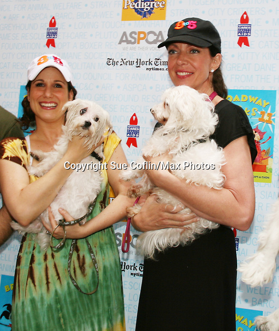 """Stephanie Block and Guiding Light's Allison Janney at Broadway Barks 11 - a """"Pawpular"""" star-studded dog and cat adopt-a-thon on July 11, 2009 in Shubert Alley, New York City, NY. (Photo by Sue Coflin/Max Photos)"""