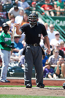 Home plate umpire Lee Myers makes a call during a game between the Fort Wayne TinCaps and Dayton Dragons at Parkview Field on August 19, 2012 in Fort Wayne, Indiana.  Dayton defeated Fort Wayne 5-1.  (Mike Janes/Four Seam Images)
