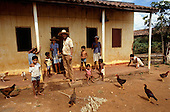 Teofilandia, Bahia State, Brazil; sisal worker family outside their house with chickens