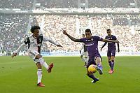 2nd February 2020; Allianz Stadium, Turin, Italy; Serie A Football, Juventus versus Fiorentina; Dalbert of Fiorentina challenges as Juan Cuadrado of Juventus crosses the ball in the box