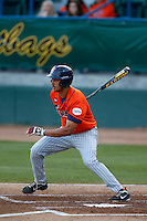Carlos Lopez #17 of the Cal State Fullerton Titans bats against the Long Beach State 49'ers at Blair Field on March 22, 2013 in Long Beach, California. (Larry Goren/Four Seam Images)