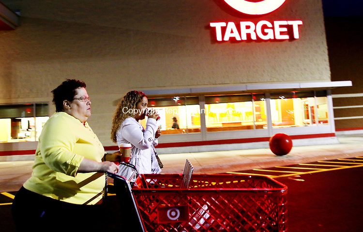 WATERBURY CT. 26 November 2015-112715SV01-Elizabeth Santiago and her daughter Alexa Santiago both of Waterbury stop by Target to pick up a few items at 6am in Waterbury Friday. The two started shopping at 3pm Thursday, took a 2 hour nap and continued with their Black Friday shopping. <br /> Steven Valenti Republican-American