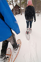 A couple enjoys snowshoeing at the Keweenaw Mountain Lodge in Copper Harbor Michigan in winter.