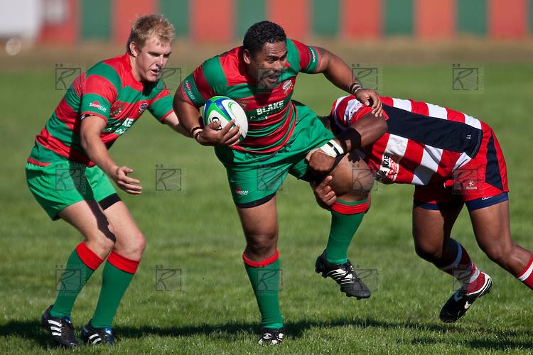hanging onto 1 leg Viliame Setitaia tries to holt the run of Sosefo Kata.   Counties Manukau Premier Club Rugby game bewtween Waiuk & Karaka played at Waiuku on Saturday April 11th, 2010..Karaka won the game 24 - 22 after leading 21 - 9 at halftime.