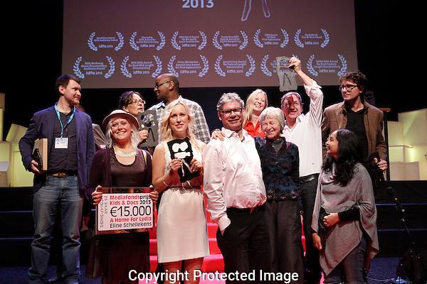 Amsterdam, november 29, 2013<br /> International Documentary Film Festival Amsterdam<br /> IDFA<br /> Awards Ceremony: all award winners:<br /> From Left: front row: Vasily Bogatov, Eline Helena Schellekens, Mona Friis Bertheussen, Peter Lataster, Petra Lataster, Farida Pacha. Back row: unidentified, Khalo Matabane, Wiebke Grundler, Alexandre Tondowski, Ricardas Marcinkus.<br /> Photo by Felix Kalkman