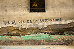 "Textured wall in Quetzaltenango, Western Highlands, Guatemala with grafitti, ""Viva el dia de la Revolucion"""