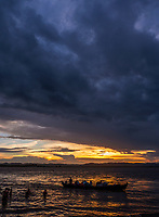 Dramatic sunset and an approaching storm at the banks of the Irrawaddy River in Mandalay