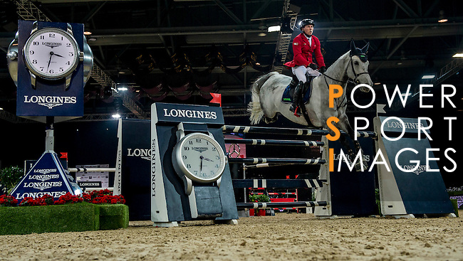 Hans-Dieter Dreher of Germany rides Cool And Easy in action during the Longines Grand Prix as part of the Longines Hong Kong Masters on 15 February 2015, at the Asia World Expo, outskirts Hong Kong, China. Photo by Victor Fraile / Power Sport Images