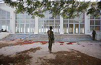 A member of the Somali National Army stands guard outside Parliament House