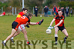 Valentia's Muiris O'Sullivan shoots but the block from Sneem/Derrynane's Conor O'Brien denies the score.