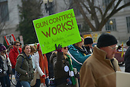 January 26, 2013  (Washington, DC)  A woman holds a sign in support of gun control sign during the March on Washington for Gun Control.  (Photo by Don Baxter/Media Images International)