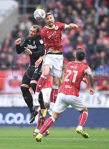 21st October 2017, Ashton Gate, Bristol, England; EFL Championship football, Bristol City versus Leeds United; Joe Bryan of Bristol City and Pierre-Michel Lasogga of Leeds United compete in the air
