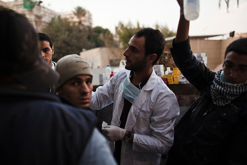 Volunteer doctors treat Egyptian protesters affected by tear gas inhalation during clashes in Cairo's Tahrir Square, November 21, 2011. Photo: Ed Giles.