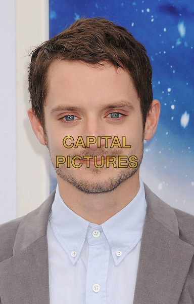 Elijah Wood.The World Premiere of 'Happy Feet Two' held at The Grauman's Chinese Theatre in Hollywood, California, USA..November 13th, 2011.headshot portrait stubble facial hair grey gray white blue shirt .CAP/ROT/TM.©Tony Michaels/Roth Stock/Capital Pictures