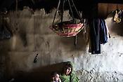 Aisha Khatoon with her grand daughter, Muniya in their hut in Shivpur Hariyya village in Raxaul district of Bihar, India. Muniya's mother Ravina Khatoon died few days after giving birth to Muniya.