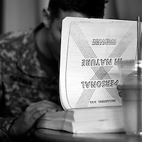 A soldier who wished to remain unidentified browses through his massive personal medical file at a coffee shop in Colorado Springs, Colo., Thursday, May 3, 2007. The man suffers from post-traumatic stress disorder from duty in Iraq. He feels officials at Ft. Carson, in Colorado Springs, Colo., are not treating his condition. (Kevin Moloney for the New York Times)