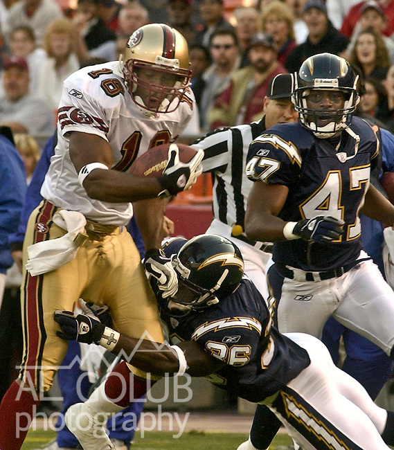 San Diego Chargers defensive back Vernon Fox (36) tackles San Francisco 49ers wide receiver James Jordan (18) on Wednesday, August 28, 2002, in San Francisco, California. The 49ers defeated the Chargers 27-3, during a preseason game.