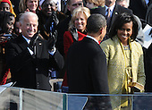 Washington, DC - January 20, 2009 -- First lady Michelle Obama (R) smiles at President Barack Obama after he was sworn-in as the 44th President of the United States on the west steps of the Capitol on Tuesday, January 20, 2009.  At left is Vice President Joe Biden and wife Jill.  .Credit: Pat Benic - Pool via CNP