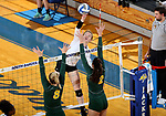 BROOKINGS, SD - SEPTEMBER 24: Makenzie Hennen #3 from South Dakota State tips the ball against Bella Lien #8 and Allie Mauch #2 from North Dakota State during their match Sunday evening at Frost Arena in Brookings. (Photo by Dave Eggen/Inertia)