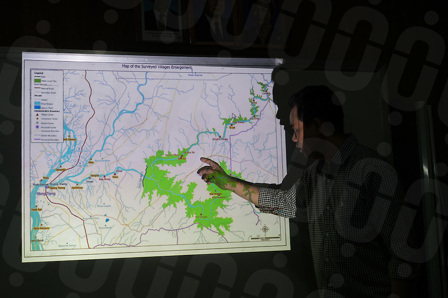 August 16, 2016 - Stung Treng (Cambodia). Ouch Vibol, an activist at CEBA (Cultural and Environment Preservation Association of Cambodia) shows a map with the areas - indicated in green - that will be flooded once the construction of the Lower Sesan II dam will be completed.  © Thomas Cristofoletti / Ruom