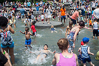 New Yorkers and visitors escape the heat in the fountain in Washington Square Park in Greenwich Village in New York during the Billion Bubble Party on Sunday, June 11, 2017. Temperatures breached 90 degrees in the city and the blistering heat is expected during the next two more days giving the city a heat wave. ( © Richard B. Levine)