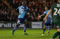 Adebayo Akinfenwa of Wycombe Wanderers celebrates scoring his side's second goal with Paris Cowan-Hall during the Sky Bet League 2 match between Plymouth Argyle and Wycombe Wanderers at Home Park, Plymouth, England on 26 December 2016. Photo by Mark  Hawkins / PRiME Media Images.