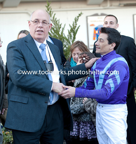 Jockey Chris DeCarlo and owner Ed Stanco chat after winning the Busanda Stakes with Princess of Sylmar on Jan. 5.