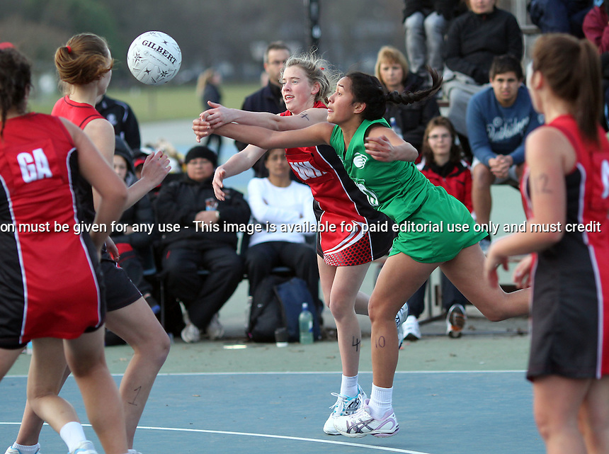 12.07.2012 Counties Manukau v Manawatu in action during the final of the Under 17 Age Group Netball Champs played at Hagley Park in Christchurch. Mandatory Photo Credit ©Michael Bradley.
