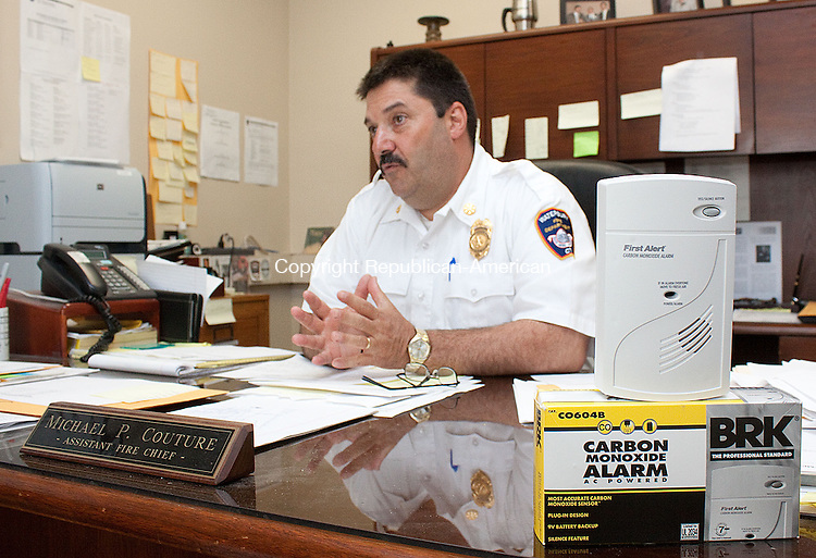 WATERBURY CT-MAY 22 2013- 052213DA05- City of Waterbury Fire Department Assistant Chief Michael P. Couture talks about the area fire departments which have been offering free carbon monoxide detectors as part of their ongoing programs for the safety of the community..Darlene Douty Republican American