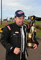 Mar. 12, 2012; Gainesville, FL, USA; NHRA top alcohol dragster driver Chris Demke celebrates after winning the Gatornationals at Auto Plus Raceway at Gainesville. The race is being completed on Monday after rain on Sunday. Mandatory Credit: Mark J. Rebilas-