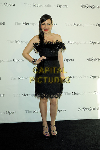 "FABIOLA BERACASA .The Metropolitan Opera Gala Premiere of ""Armida"" at the Metropolitan Opera House at Lincoln Center,  New York, NY, USA, 12th April 2010..full length black dress strapless feathers feather trim lace clutch bag hand on hip platform peep toe shoes sandals .CAP/ADM/BM.©Bill Menzel/AdMedia/Capital Pictures."