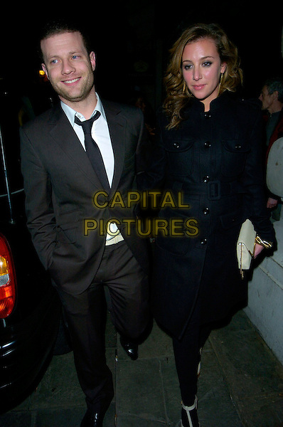 DERMOT O'LEARY & GUEST.The Brit Awards 2007 Oasis after party, Cuckoo Bar & Nightclub, London, UK..February 14th, 2007.brits full length black suit coat Dermott .CAP/CAN.©Can Nguyen/Capital Pictures