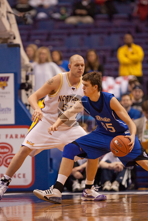 March 5,  2010              Drake center Seth VanDeest (45) drives under the basket as he's guarded by Northern Iowa center Jordan Eglseder (53) in the second half.   The University of Northern Iowa Panthers played the Drake University Bulldogs in Game 3 of the Missouri Valley Conference Tournament at the Scottrade Center in downtown St. Louis, MIssouri on Friday March 5, 2010.  The Bulldogs advanced to play the Panthers on the second day of competition after defeatiing the Southern Illinois University-Carbondale Salukis in Game 1.  Northern Iowa won, 55-40 and advances.