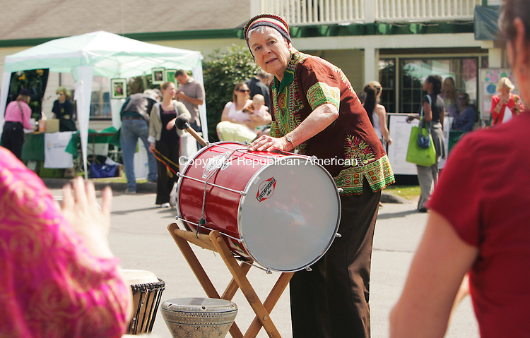 WOODBURY, CT-2 APRIL 2010-042410JS02-Evelyn Williams of Roxbury plays her drum with other members of The Offbeats, a rhythm drumming ensemble from Northwest Connecticut, as they entertain the crowd during the annual Earth Day celebration Saturday at New Morning Natural and Organics in Woodbury.  <br /> Jim Shannon Republican-American