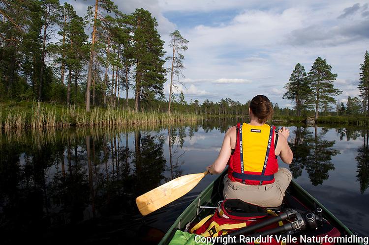Jente i kano. ---- Girl in canoe.