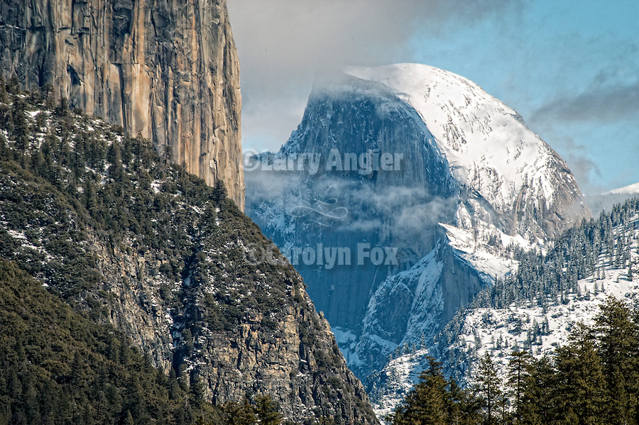 Face of El Capitan; Half Dome with dusting of snow, late winter. Yosemite National park