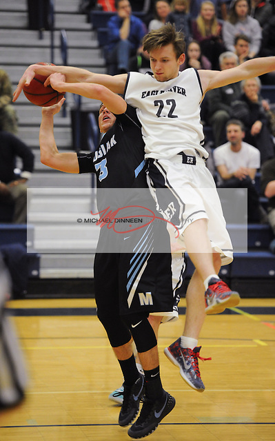 Eagle River's Andrew Murray (22) fouls Chugiak's Hunter Harr at Eagle River High School Tuesday January 19, 2016.  Photo for the Star by Michael Dinneen.