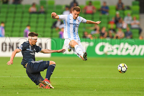 13th February 2018, AAMI Park, Melbourne, Australia; AFC Champions League football, Melbourne Victory versus Ulsan Hyundai; James Donachie of the Melbourne Victory slide tackles as Mislav Orsic of Uslan Hyundai jumps over the challenge