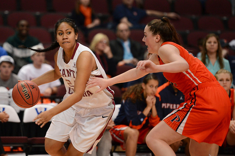 March 6, 2014; Las Vegas, NV, USA; Santa Clara Broncos forward Arteivia Lilomaiava (24) dribbles against the Pepperdine Waves during the first half of the WCC Basketball Championships at Orleans Arena. The Waves defeated the Broncos 80-74.