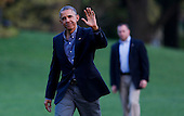 United States President Barack Obama waves to the media as he returns to the White House after traveling to the Florida Everglades to deliver remarks on the threat that climate change poses to the US economy, April 22, 2015 in Washington, DC. <br /> Credit: Aude Guerrucci / Pool via CNP